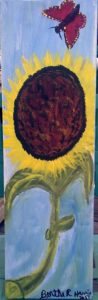 Single sunflower painted on board
