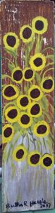 Multiple sunflowers painted on board